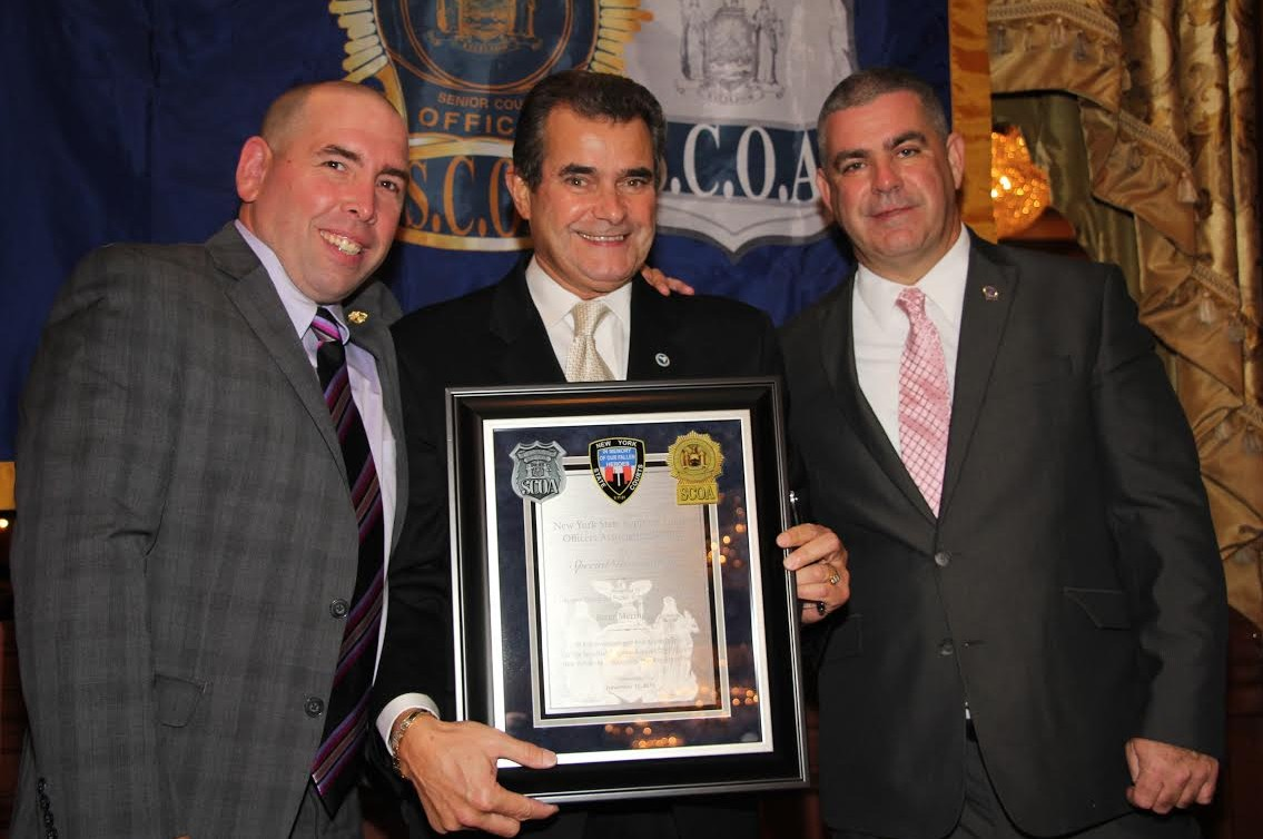 Patrick Cullen (left) and his vice president Patrick O'Malley (right) presented Peter Meringolo with the Special Recognition Award.