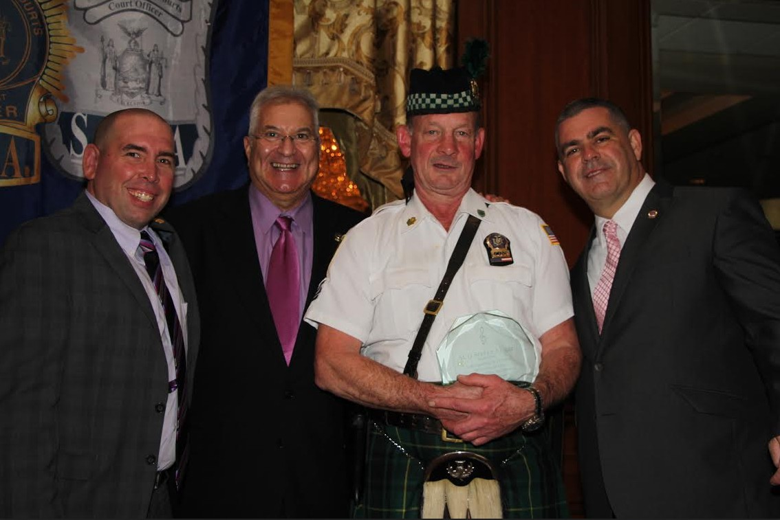 Drum Sgt. Steve Allgor (second from right) was presented with a special plaque for his 30 years of service as a court officer and 27 years as a member of the New York State Court Pipes and Drums. Pictured from left with Patrick Cullen, Hon. Bruce Balter a